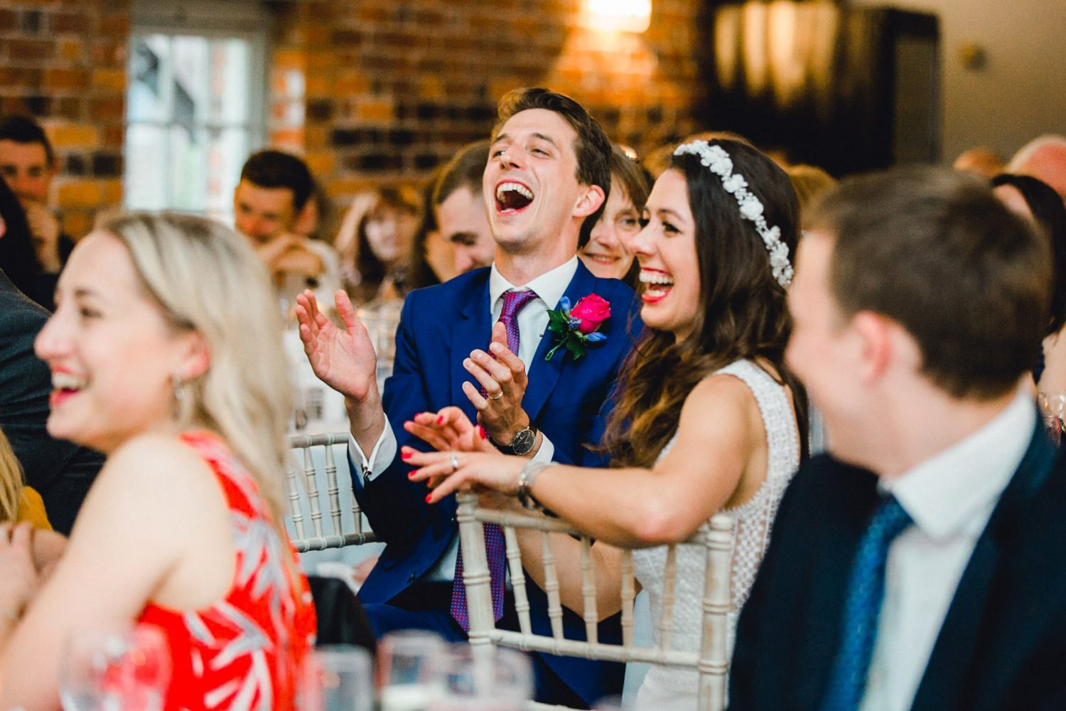 Laughing groom at sopley mill wedding
