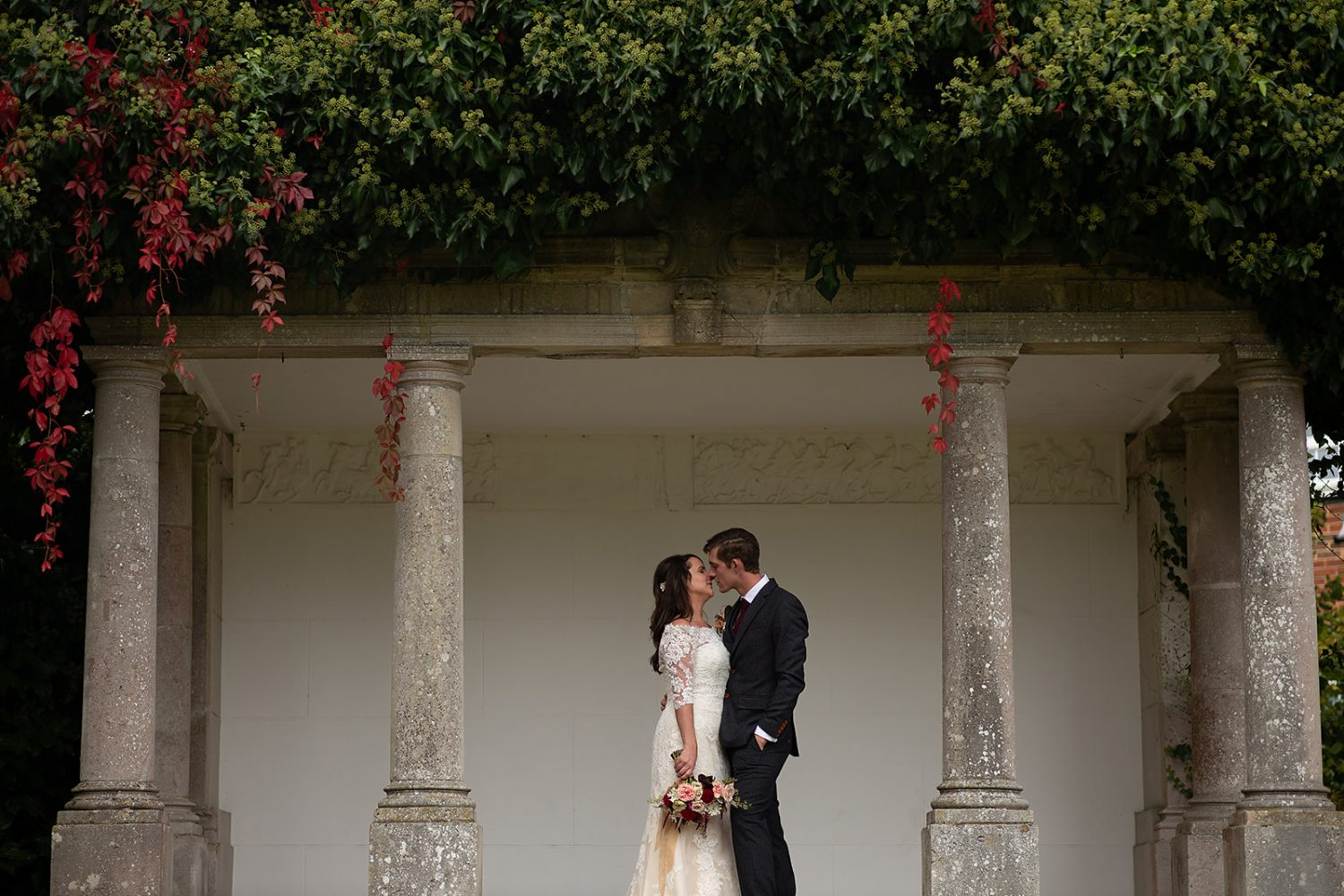 bride and groom standing together and kissing