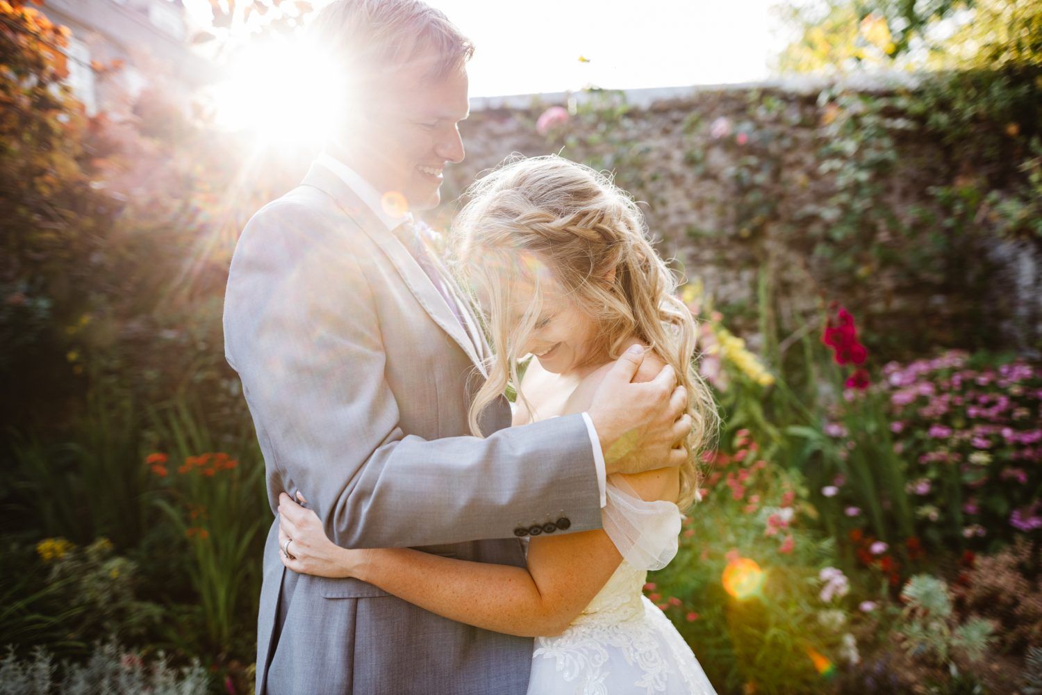 Wedding couple in golden hour light with sunflare