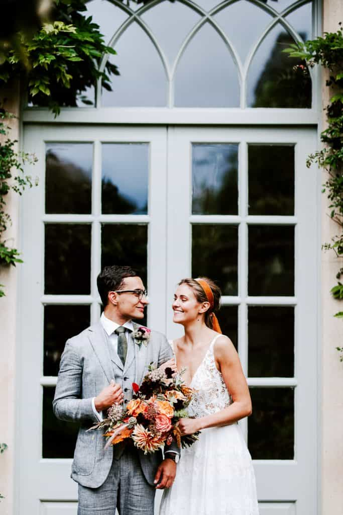 Bride and groom in doorway at euridge manor
