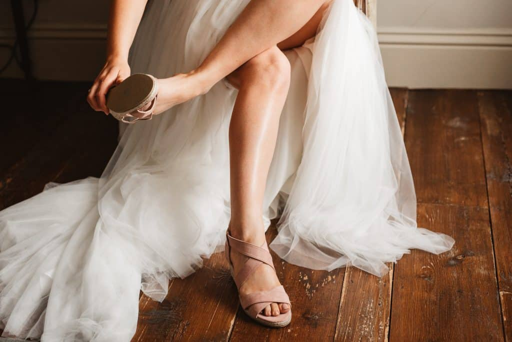 Bride putting on her shoes