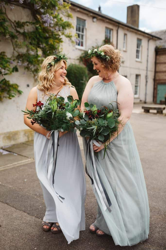 Bridesmaids in sage and grey dresses