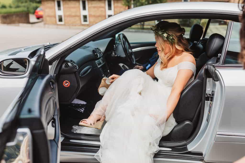 Birde arriving in wedding car at Knighton house