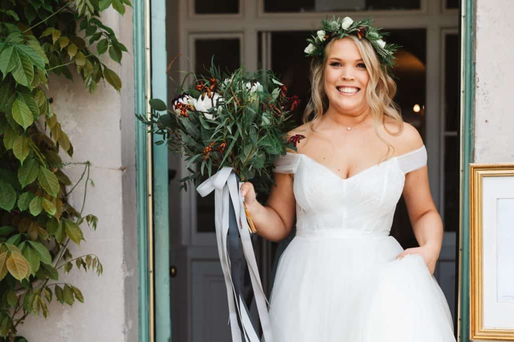 Bride with bouquet looking happy and smiling