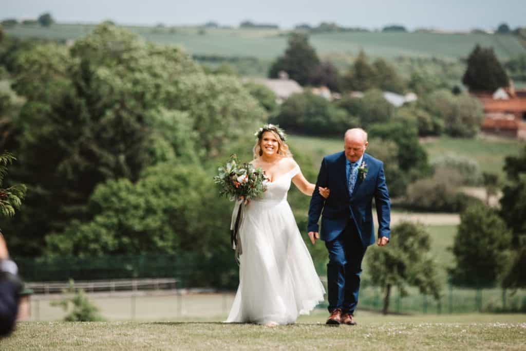 bRIDE ARRIVES WITH DAD AT KNIGHTON HOUSE WEDDING