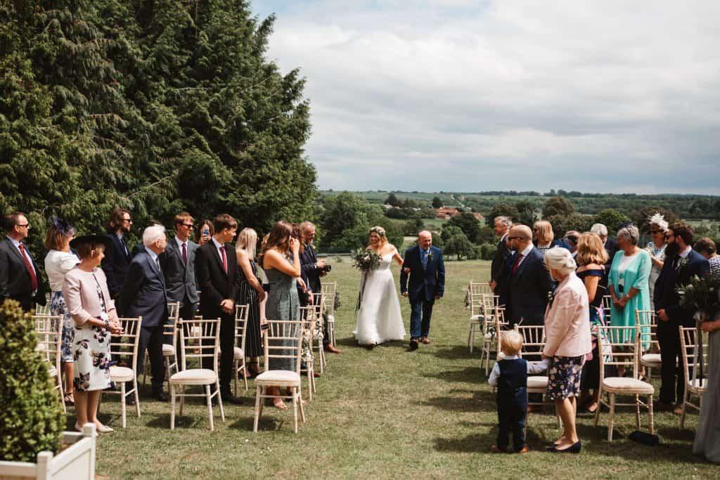 bRIDE ARRIVES WITH DAD AT KNIGHTON HOUSE WEDDING VENUE
