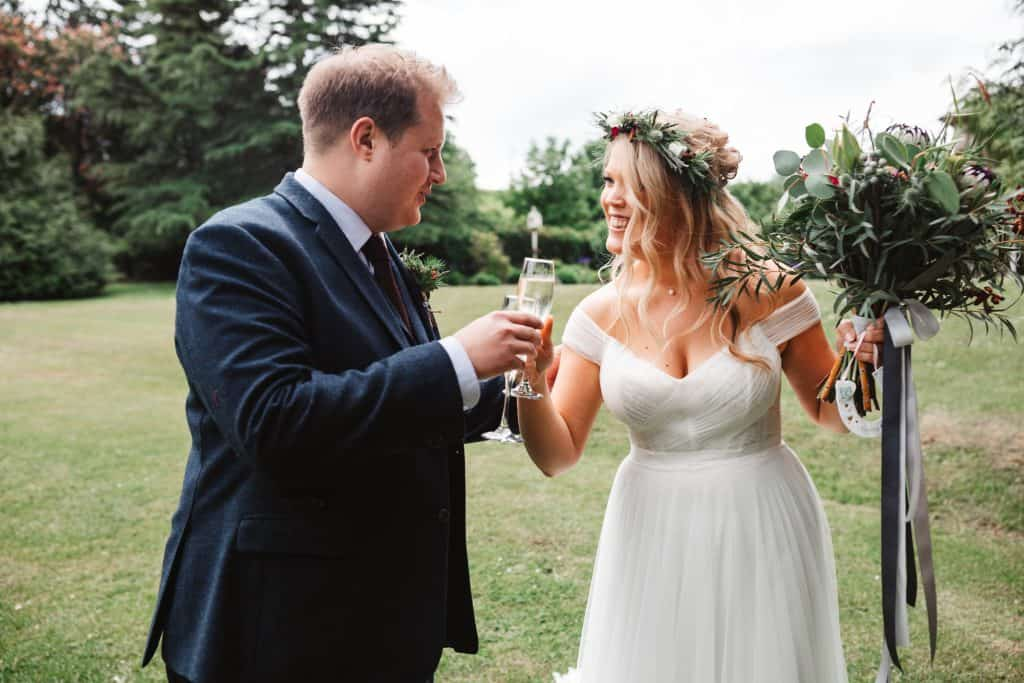 Bride and groom saying cheers after getting married
