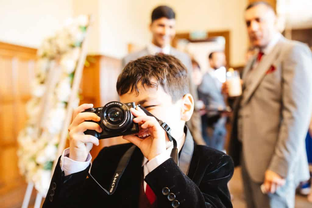 wedding guests with camera